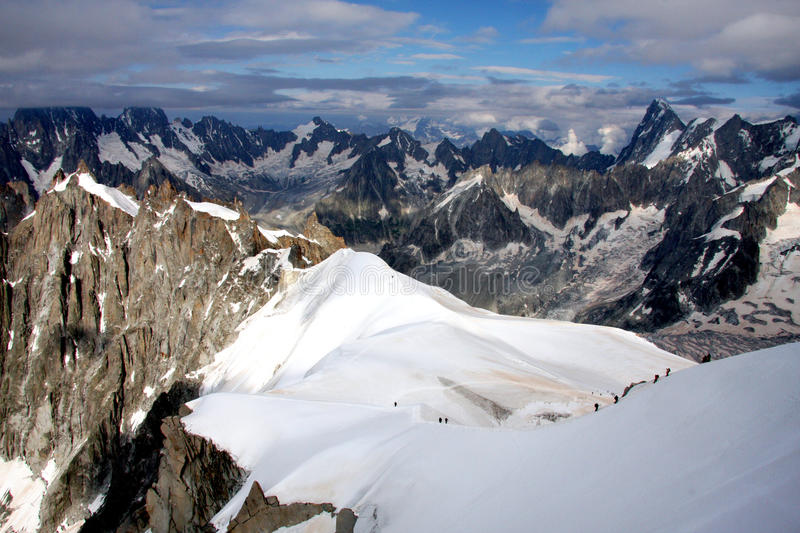 French Alps. The Alps are one of the great mountain range systems of Europe stretching approximately 1,200 kilometres (750 mi) across eight Alpine countries royalty free stock photos