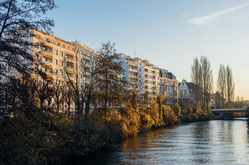 French apartment buildings alongside Ill river bankside stock image