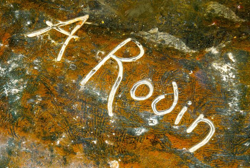 Sculptor Rodin Signature at Base of Outdoor Sculpture stock photography