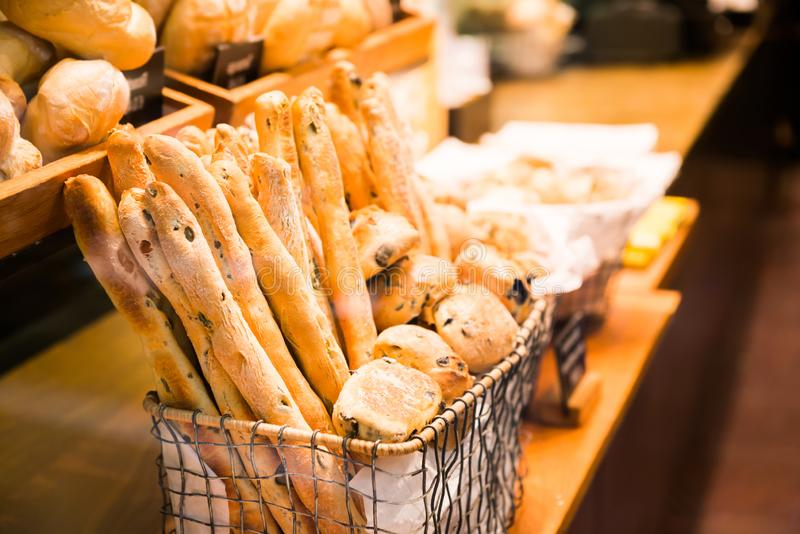 French baguette and bread in basket. In bakery stock photography