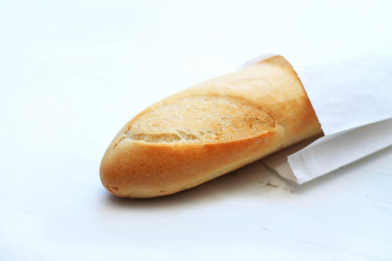 French baguettes, loaves on a light wooden background stock photography