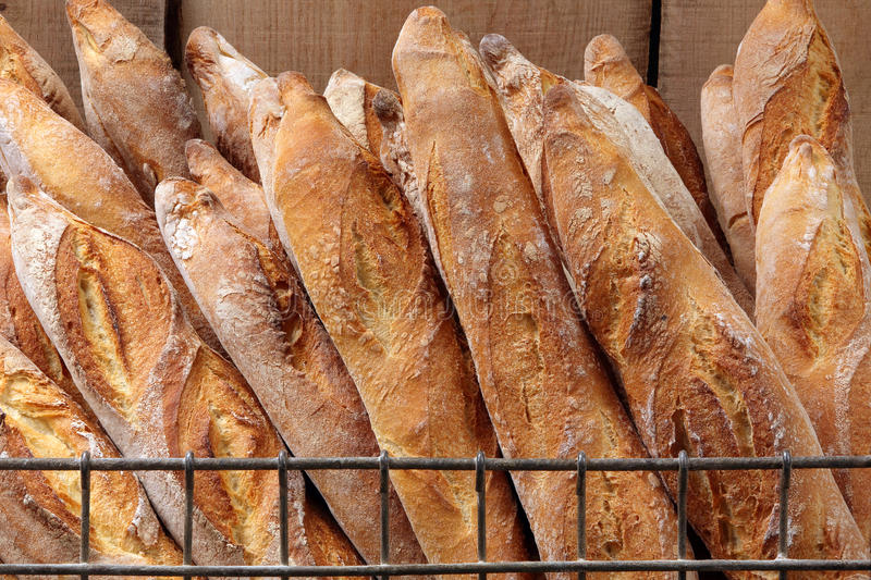 French baguettes in metal basket in bakery.  royalty free stock images