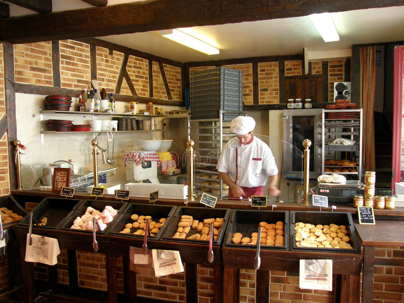 French bakery. Man working French bakery in brittany, france 2012 stock photos