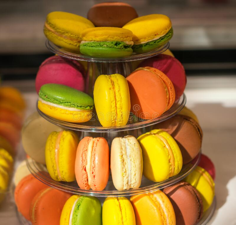 French bakery colorful macarons. Cookies with rasberry, chocolate, cacao, vanilla cream and smell stock photography