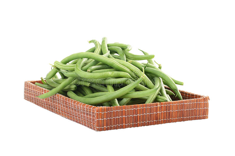 French bean. Young green French string bean in pods on a white background stock images