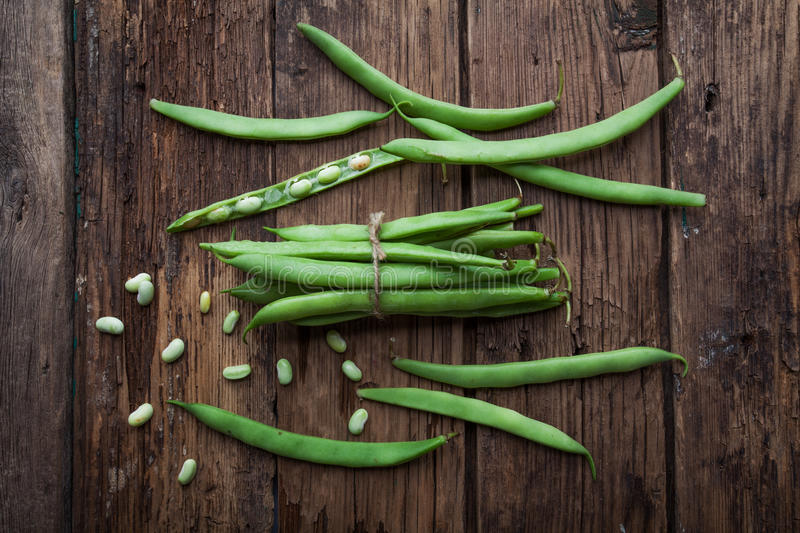 French bean on old background. French bean on old rustic background royalty free stock photos