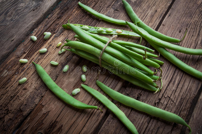 French bean on old background. French bean on old rustic background royalty free stock image