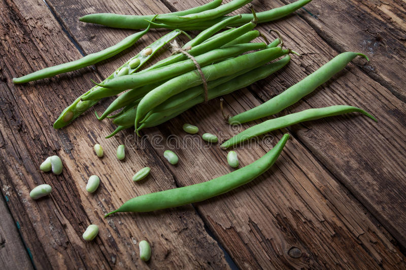French bean on old background. French bean on old rustic background royalty free stock images