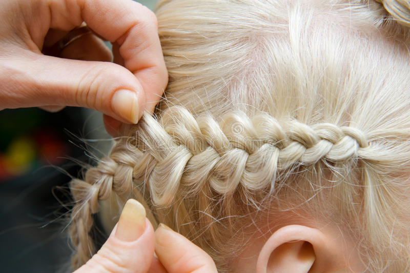 French braid. Of blond young girl royalty free stock photos