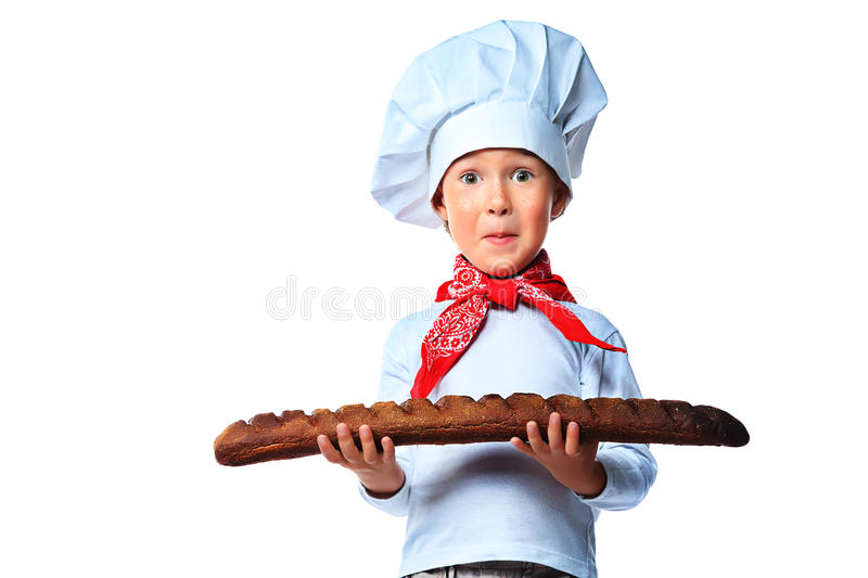 French bread. Portrait of a little kitchen boy holding french bread. Isolated over white background royalty free stock photo