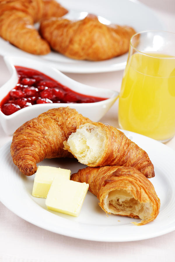 French breakfast. With croissant, butter, strawberry jam, and juice royalty free stock photography