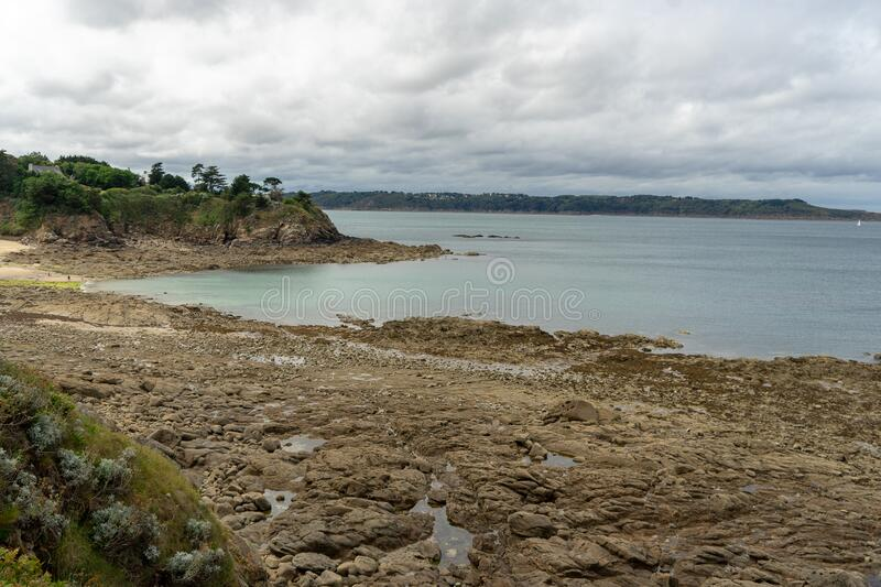 French britanny coast during tide and flow stock image
