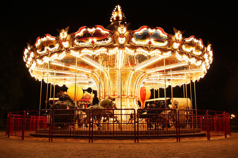Carousel (Merry-Go-Round) illuminated at night royalty free stock photo