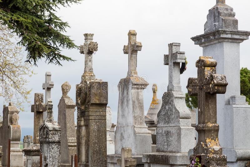 French cemetery with old stone tombstones and crosses in Carcass. Onne. Horizontal full frame composition stock photos