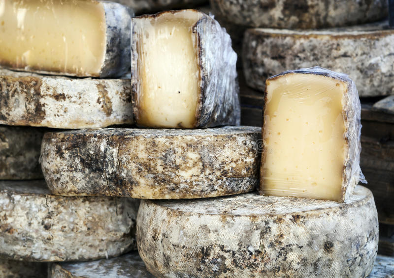 French Cheese Wheels. French artisan cheese wheels. Provence market stock image