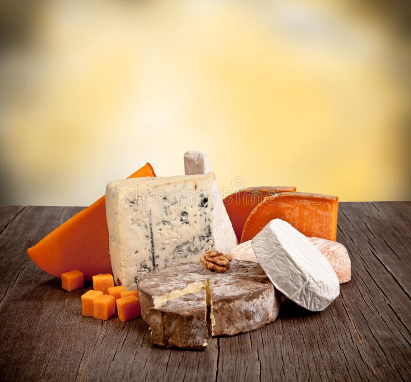 French cheeses. Delicious fresh french cheeses served on wooden table stock photos