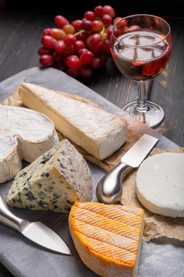 Download French Cheeses Plate In Assortment Blue Cheese Brie Munster Stock Photo & French Cheeses Plate In Assortment Blue Cheese Brie Munster ...