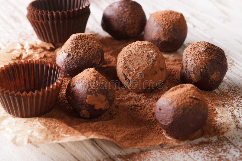 French Chocolate truffles with cocoa powder close-up paper. horizontal stock photography