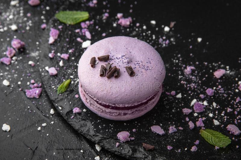 French Colorful Macarons on Black Background stock images