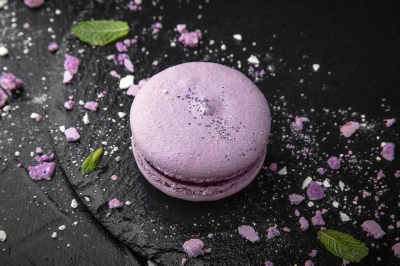 French Colorful Macarons on Black Background royalty free stock photo