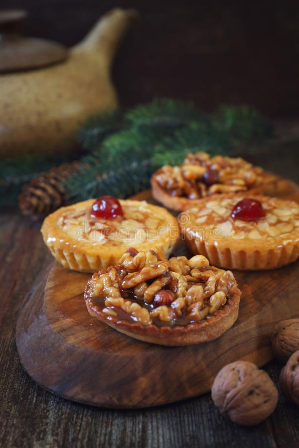 French confectionery, New Year dessert. Four mini walnut caramel tarts. stock image