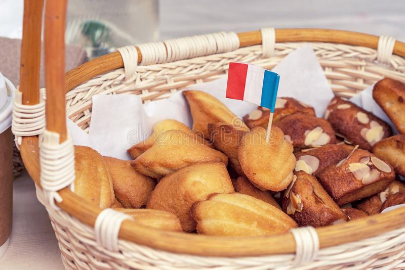French cookies in a white wicker basket. Baking and sweets from France stock photos