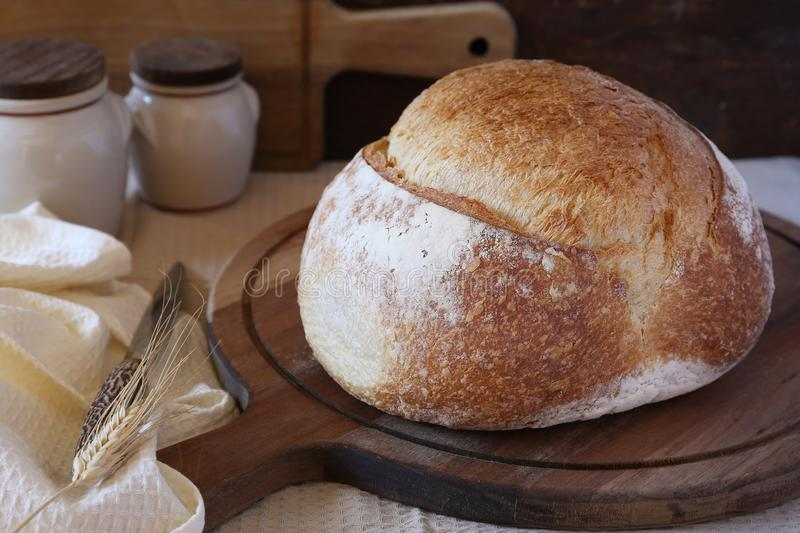 French country bread. On wooden chopping board, rustic style royalty free stock image