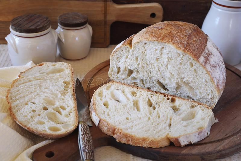 French country bread, rustic style. French country bread on wooden chopping board, rustic style royalty free stock images