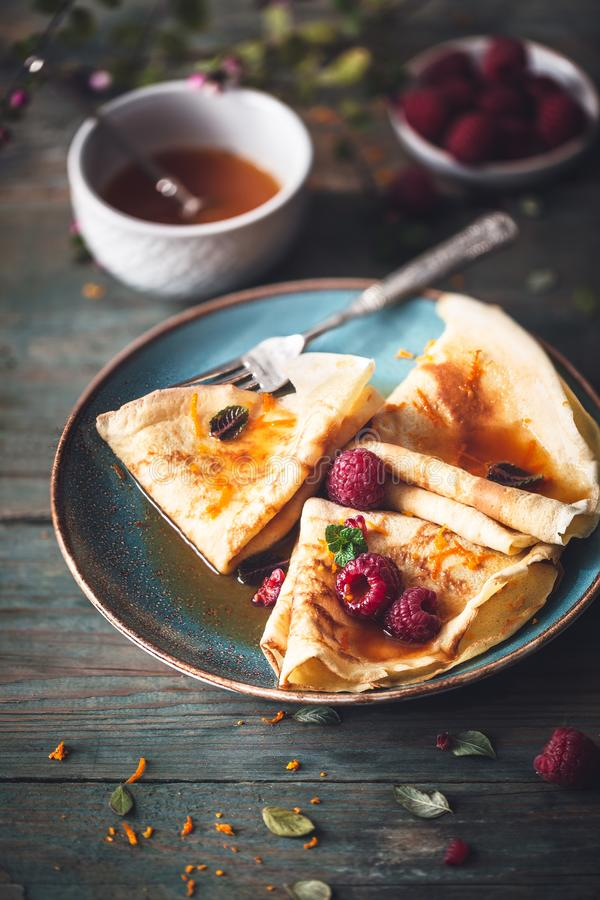 French Crepe Suzette for Chandeleur. On wooden background royalty free stock photos