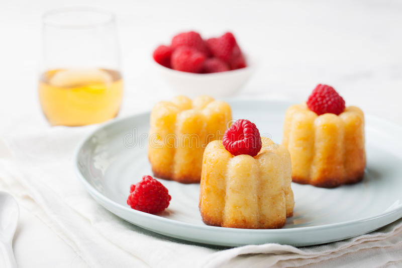 French dessert, cakes, caneles, rum baba royalty free stock images