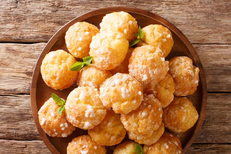 French dessert chouquette profiteroles with pearly sugar and min. T closeup on the table. Horizontal top view from above stock photography