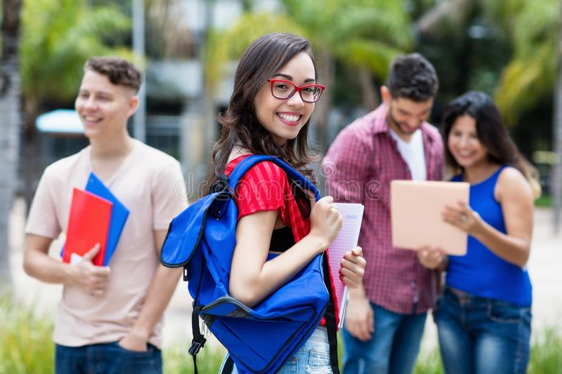 French female university student with group of students stock images