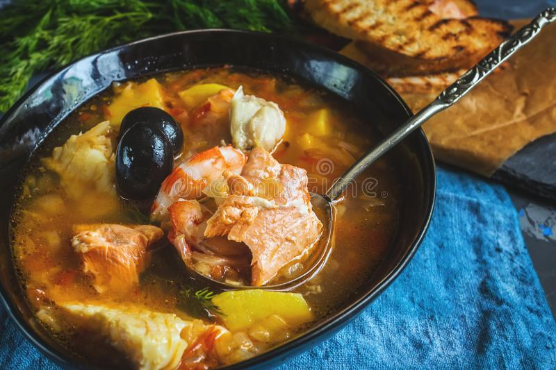French fish soup Bouillabaisse with seafood, salmon fillet, shrimp, rich flavor, delicious dinner. royalty free stock image