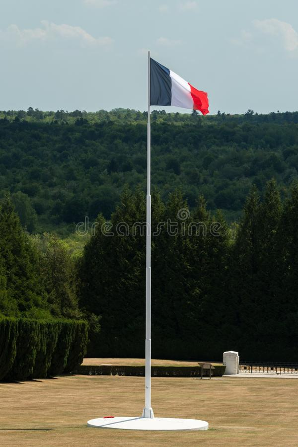 French flag in the cemetery outside of the Douaumont ossuary near Verdun France. Cemetery outside of the Douaumont ossuary near Verdun France. Memorial of the royalty free stock photography