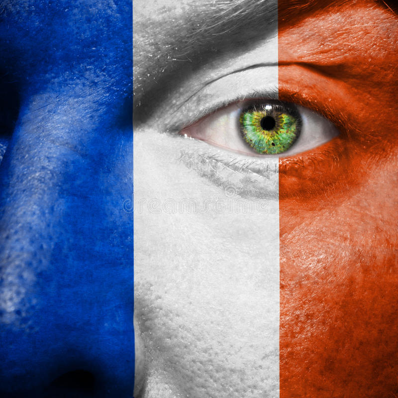 French flag painted on mans face royalty free stock photo