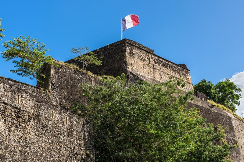 French flag on a top of Fort Saint Louis in Fort-de-France, Martinique. French flag on a top of Fort Saint Louis in Fort-de-France, France`s Caribbean overseas royalty free stock photography