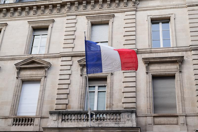 French flag waiving over city town hall royalty free stock photo