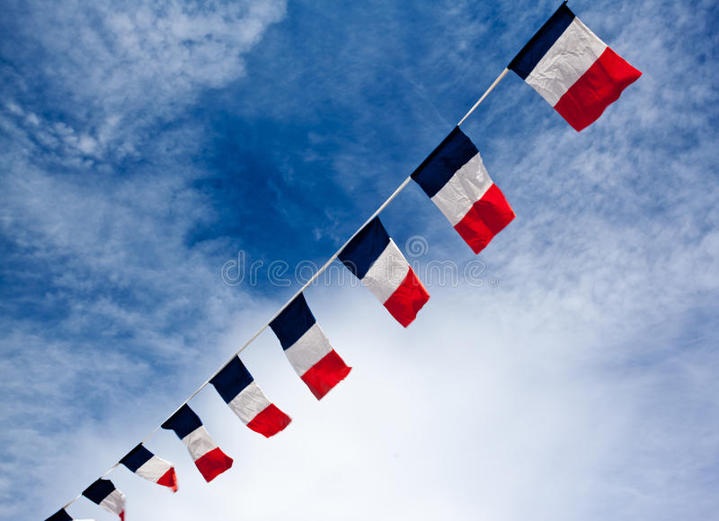 French flags w. French flags blowing in the wind stock photos