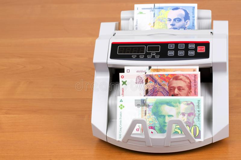 French Francs in a counting machine royalty free stock images