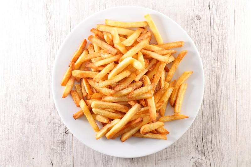 French fried on plate. Top view stock images