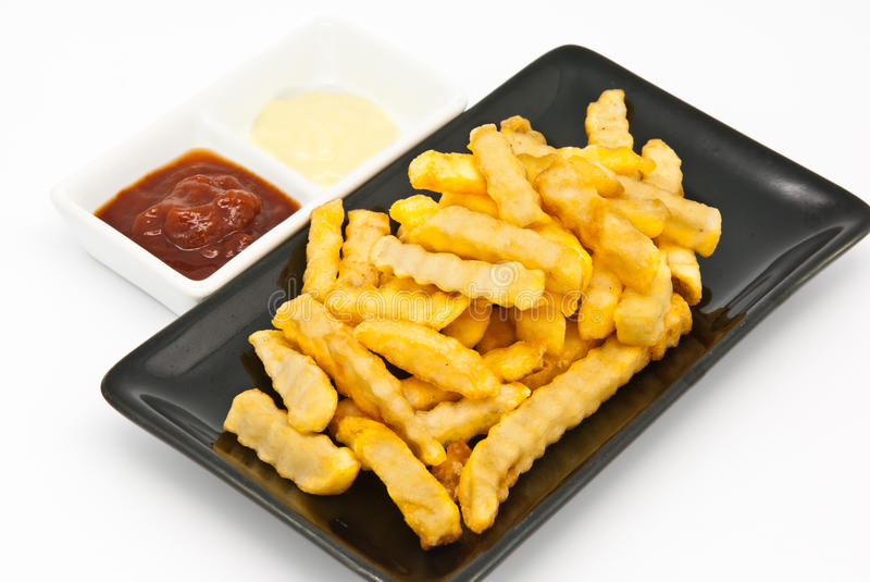 French fries in black plate stock photos