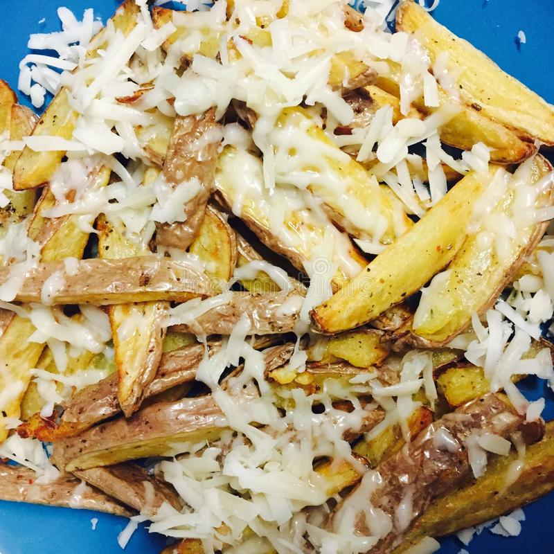 French fries with cheese. French fries with grated cheese royalty free stock images