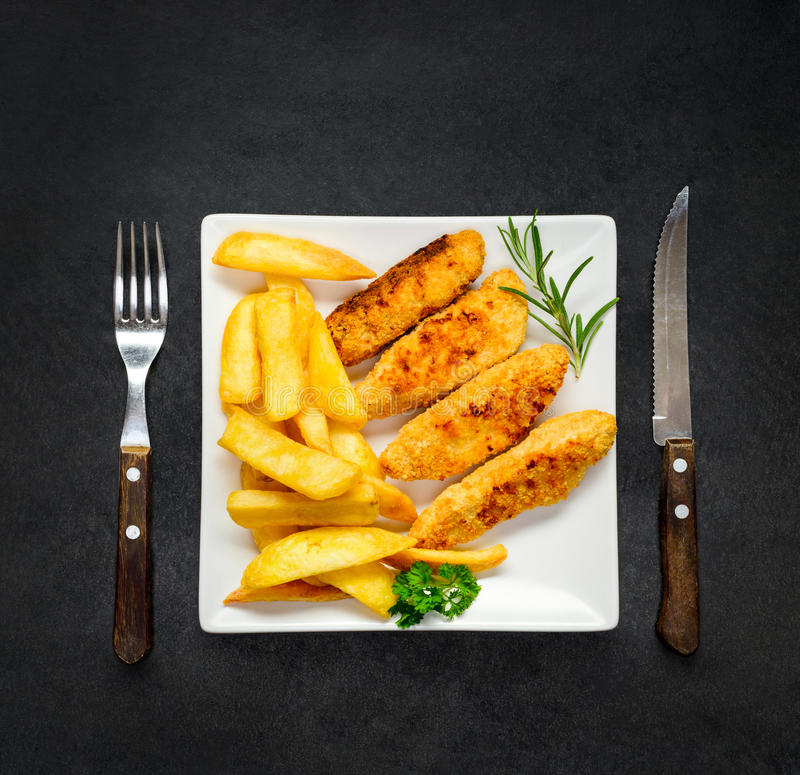 French Fries and Chicken Fingers as Dinner royalty free stock image