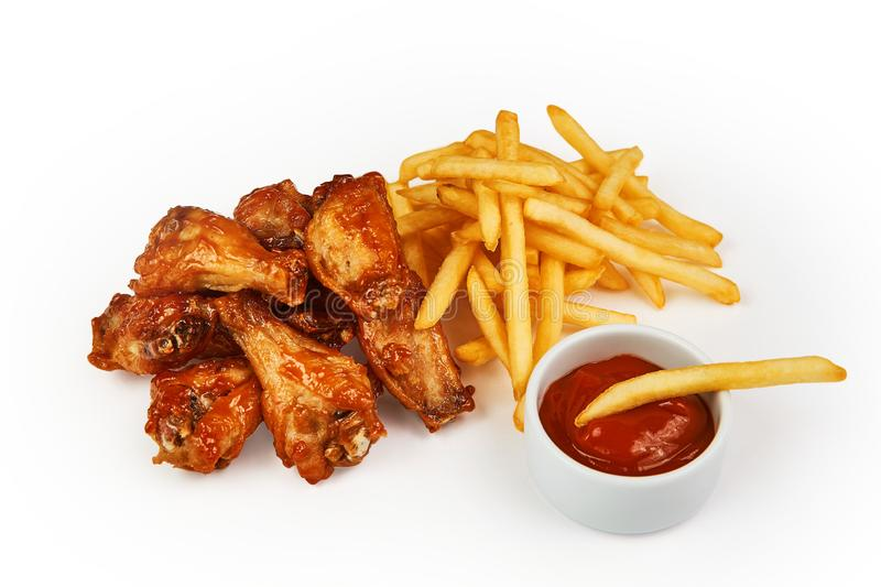 French fries, chicken and tomato sauce isolated on white with clipping path royalty free stock image