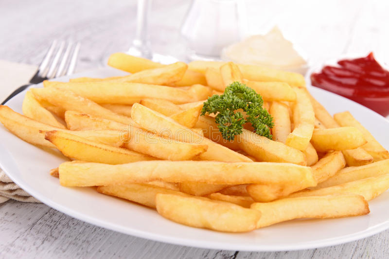 French fries. Close up on french fries and ketchup royalty free stock photography