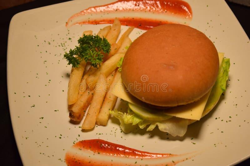 French fries, fresh tasty burger isolated on Black background stock images