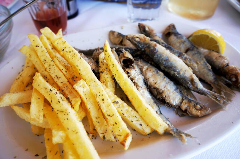 French fries and fried fish royalty free stock photo