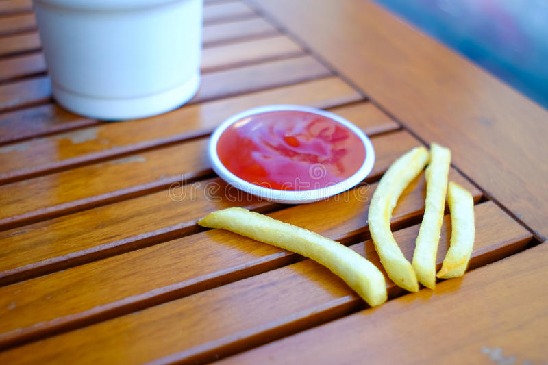 French fries. With ketchup on wooden background stock images