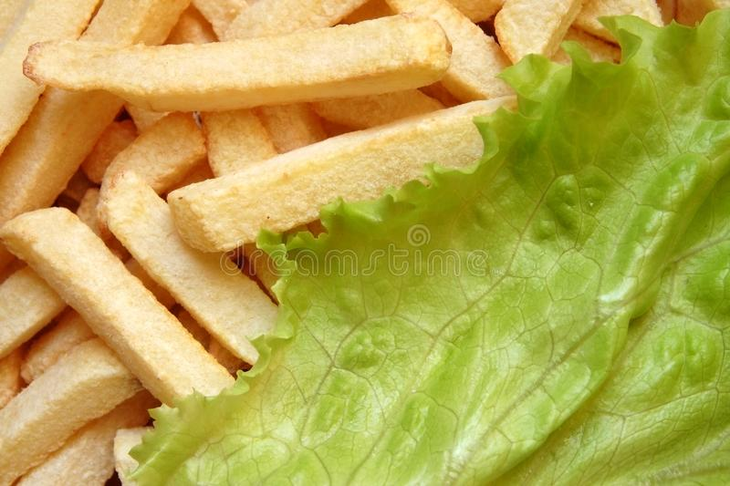 French Fries and Lettuce Salad stock photography