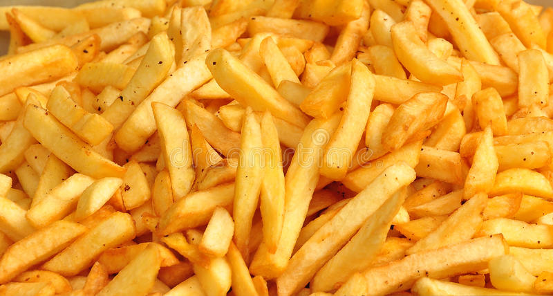 French fries. A lot of french fries royalty free stock image